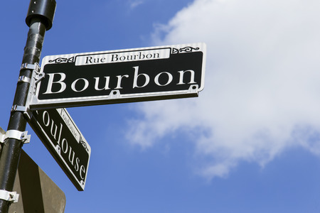 new world: Street sign for the world famous Bourbon Street in the French Quarter in New Orleans famous for its party atmosphere Stock Photo