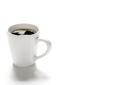 single coffee mug filled with white copyspace