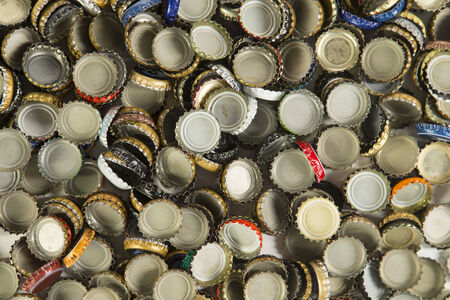 a collection of beer bottle caps representing the craft beer industry Stockfoto