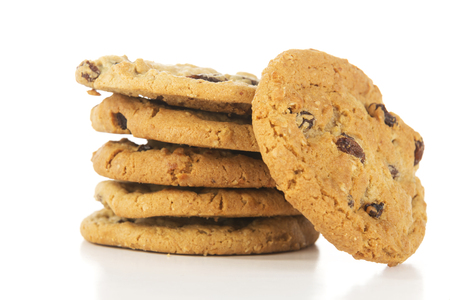 cookie on white: stack of oatmeal raising cookies hero angle