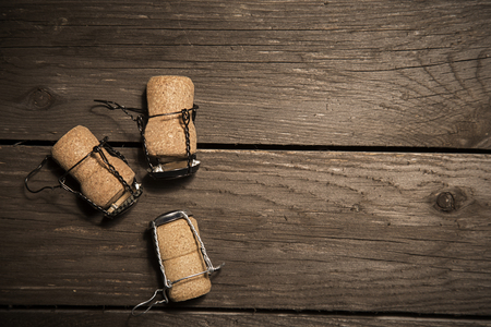 wood craft: three craft beer or wine corks on wood background with sopy space