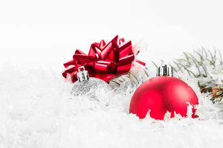 christmas background of pine tree branch snow and baubles