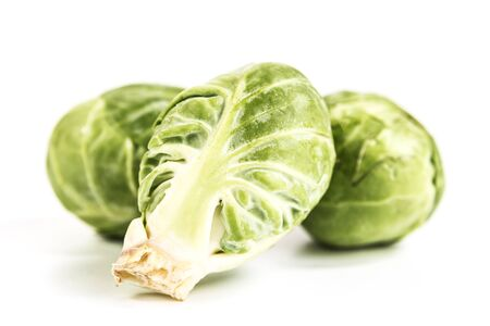 close up view of three brussel sprouts on white background Reklamní fotografie - 55026669