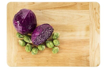 red cabbage and brussel sprouts on wood cutting board over top view