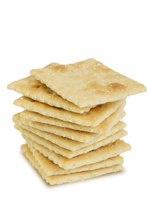 a single stack of saltine crackers on white background Reklamní fotografie