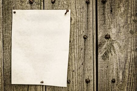 posted: blank paper for note posted on wood background with vintage look Stock Photo