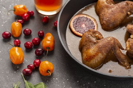 blood orange and cranberry broasted chicken wings Stock Photo