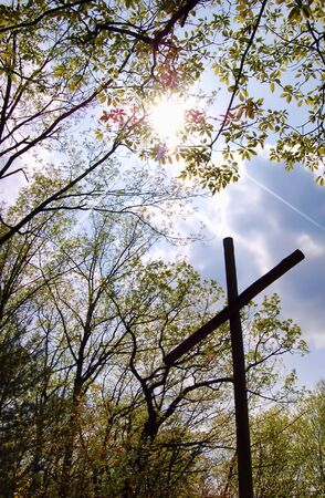 easter sunrise: easter sunrise, cross in woods with sunbeams breaking through clouds Stock Photo
