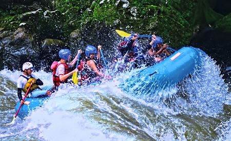 action shot of white water rafters