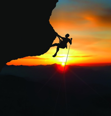 rock formations: rock climber rappelling