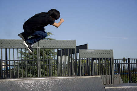 inline skater: inline skater midair off the lip of a halfpipe