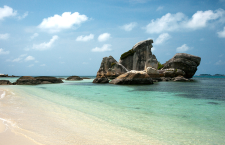 Natural rock formation in the sea and on a white sand beach in Belitung Island in the afternoon, Indonesia. Imagens - 74712091