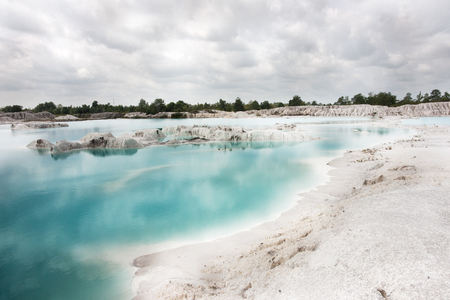 Man-made artificial lake Kaolin, turned from mining ground holes. Due to mining, holes were formed covered by rain water, forming a clear blue lake, Air Raya Village, Tanjung Pandan, Belitung Island. Stock Photo
