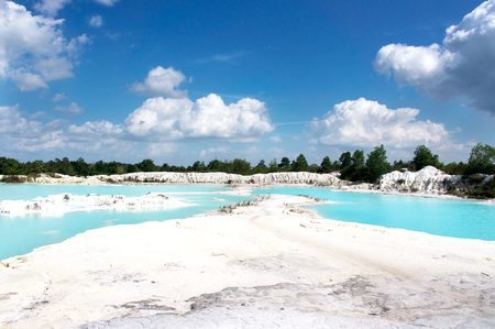 Man-made artificial lake Kaolin, turned from mining ground holes filled with rain water forming a clear blue lake, Air Raya Village, Tanjung Pandan, Belitung Island.