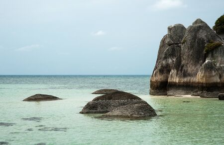 Natural coast rock formation in sea at Belitung Island in the afternoon, Indonesia. Stock Photo