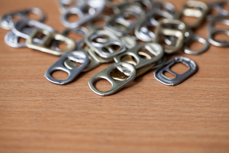 ring pull: Metal ring pull on wooden background Stock Photo