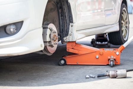 jack tar: Car jack to lift car, changing car tire Stock Photo