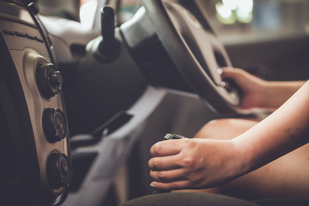 shifting: woman shifting gears on gearbox in car Stock Photo