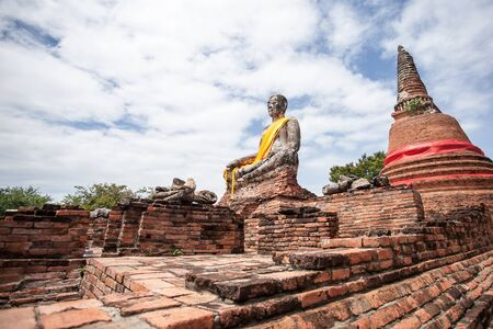 Buddha statue at the old temple in Ayutthaya, Thailand