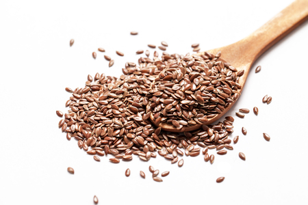 linseed: Flax seeds on white background