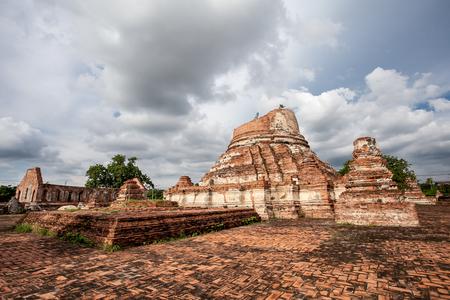 Ancient broken pagoda at Wat Kudi Dao old. The ancient temple in Ayutthaya, Thailand