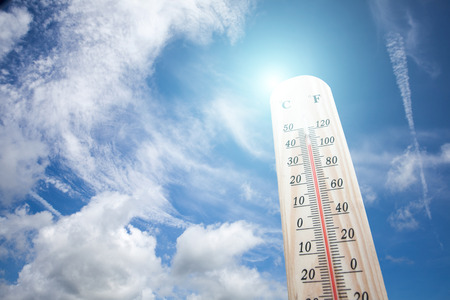 Thermometer on the summer heat Stock Photo