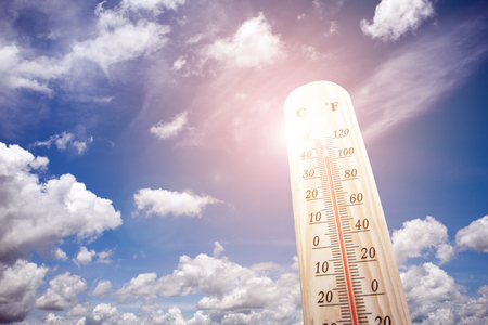 Thermometer on the summer heat Foto de archivo