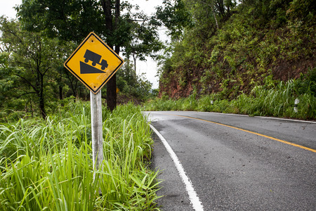 downgrade: The street sign down hill warning on the mountain road