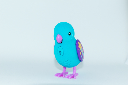 Blue bird with beak and purple wings toy with white background Reklamní fotografie