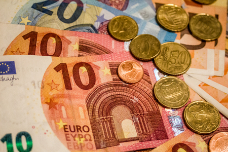 A composition of euro banknotes and coins providing great options to be used for illustrating subjects as business, banking, media, presentations etc., as well as for money related blogs or article features