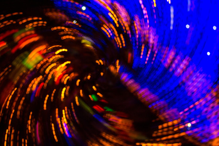 Bokeh-Abstraction: colorful wave of city lights dissolving in a sea of blue light