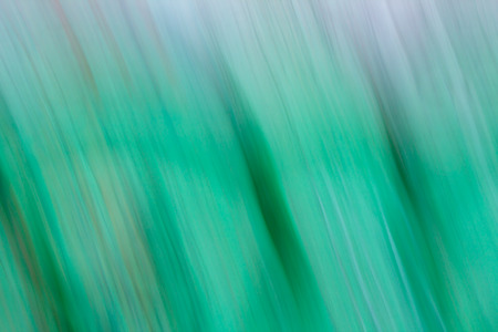 Creative abstract background resembling brush or pastel painting full of dynamics in green, blue, white, black, gray etc. Stock Photo