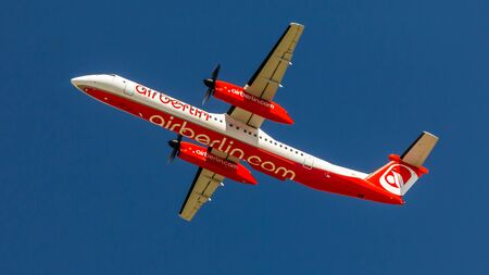 Berlin, Germany, 07.07.2018: Air Berlin Bombardier Q400 aircraft flying in the sky, Tegel Airport