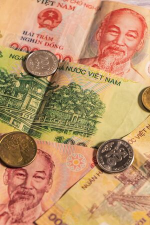 A composition of Vietnamese dong VND banknotes and coins providing great options to be used for illustrating subjects as business, banking, media, presentations etc.