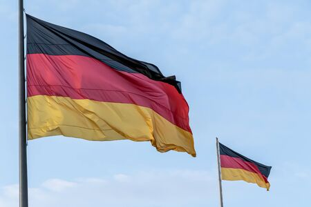 Federal Republic of Germany, German national flag waving on the blue sky background, DE Stock fotó - 142109974