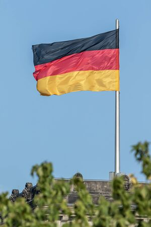 Federal Republic of Germany, German national flag waving on the blue sky background, DE
