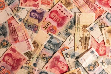 A composition of Chinese Renminbi RMB. People's Currency. Yuan CNY banknotes providing great options to be used for illustrating subjects as business, banking, media, etc.