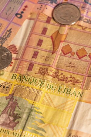 A composition of Lebanese lira LL. Lebanese pound LBP banknotes and coins providing great options to be used for illustrating subjects as business, banking, media, presentations etc.