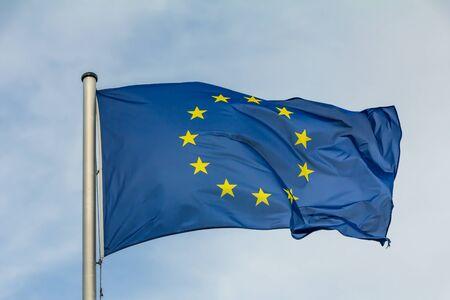 EU, Europe, European Union flag waving on blue sky background