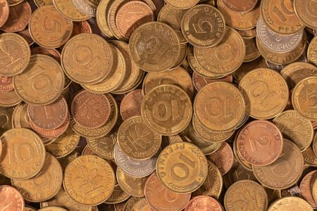 Thousands of golden, silver and copper coins providing great options to be used for illustrating subjects as business, banking, media, etc.