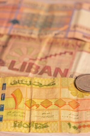 A composition of Lebanese lira LL. Lebanese pound LBP banknotes and coins providing great options to be used for illustrating subjects as business, banking, media, presentations etc. Stock fotó