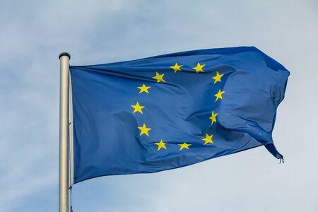 EU, Europe, European Union flag waving on blue sky background Standard-Bild