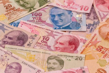 A composition of Turkish lira TL. TRY banknotes providing great options to be used for illustrating subjects as business, banking, media, etc.