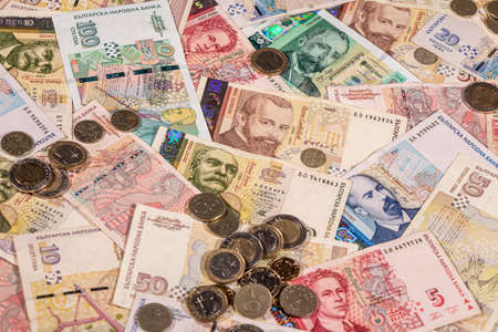 A composition of Bulgarian lev banknotes and coins providing great options to be used for illustrating subjects as business, banking, media etc.