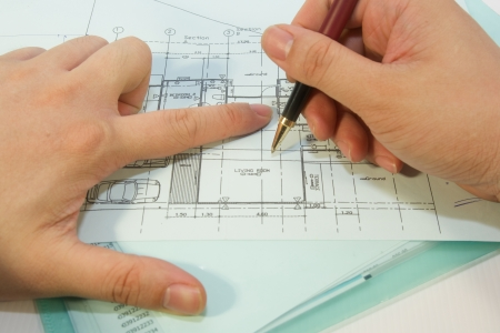 stock photo architects are re-designing a living room blueprint photo