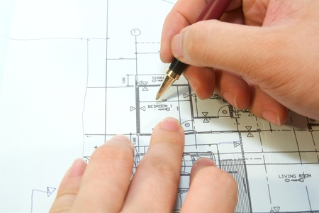 stock photo architects are re-designing a bedroom blueprint photo