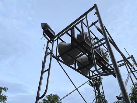 Horn speaker on scaffolding with sky background