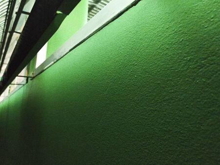 Green cement wall with night light