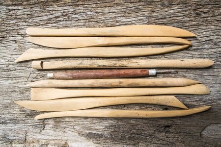 Pottery tools on wood background Stok Fotoğraf
