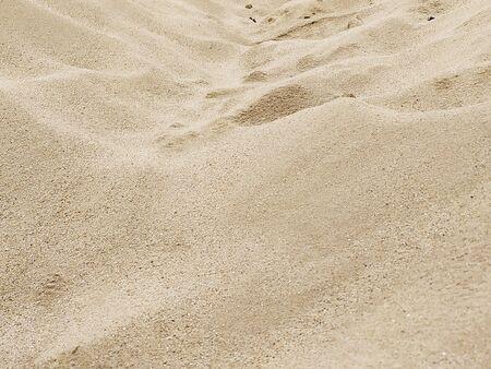 Gros plan de sable fin pour les travaux de construction, fond de texture sable fin
